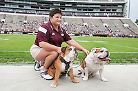 Super Bulldog Weekend Maroon and White game at Davis Wade - new Bully XXI, &quot;Jak&quot; takes over the harness from Bully XX, his father &quot;Champ&quot;, with MSU mascot handler, Lisa Pritchard.<br />  (photo by Megan Bean / &copy; Mississippi State University)