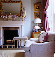 The smoky blue colour of the drawing room is the perfect backdrop for a collection of gilt-framed paintings and objects