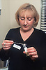 Female doctor examining urine test sample,