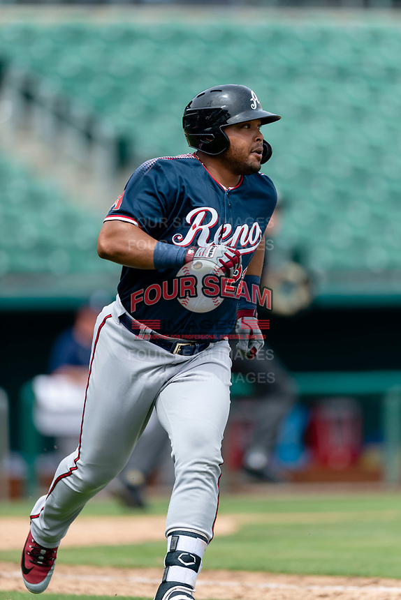 Reno Aces first baseman Yasmany Tomas (23) jogs towards first base after hitting a single during a game against the Fresno Grizzlies at Chukchansi Park on April 8, 2019 in Fresno, California. Fresno defeated Reno 7-6. (Zachary Lucy/Four Seam Images)