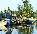 Hoi An Fishing Boats 01 - Fishing boats reflected in the Thu Bon river, early morning, Hoi An, Viet Nam