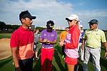Ricky Chan (in orange and red), Natalie Gulbis, Danny Lau (in green), and Wu Zhoutong (in purple) at the end of their game during the World Celebrity Pro-Am 2016 Mission Hills China Golf Tournament on 23 October 2016, in Haikou, Hainan province, China. Photo by Marcio Machado / Power Sport Images