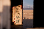 Graffiti on the walls of the old radar building, Santa Rosa Range through the window of an abandoned radar station, Humboldt Co., Nev.