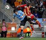 Jorge Fucile (4) Stephen Appiah (10) Soccer, Football - 2010 FIFA World Cup - Johannesburg, South Africa, Friday, July, 02,  2010. Uruguay vs Ghana, Round of 8, Quarter-finals, Soccer City Stadium (credit & photo: Pedja Milosavljevic / +381 64 1260 959 / thepedja@gmail.com / STARSPORT )