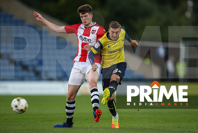 Joe Rothwell of Oxford United fires a shot past Liam McAlinden of Exeter City during the The Checkatrade Trophy match between Oxford United and Exeter City at the Kassam Stadium, Oxford, England on 30 August 2016. Photo by Andy Rowland / PRiME Media Images.