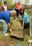 SHARON, CT- 26 APRIL 2008 --042608JS14-Wayne Skidgel of Wast Hartford, left, helps Nathaniel Purdy, center, and Sheri Rybczyk, both 8th grade student at Sharon Center School, replace a grave stones in Hillside Cemetery in Sharon on Saturday. The clean up and restoration project was part of a program by the Sharon Historical Society. <br /> Jim Shannon / Republican-American