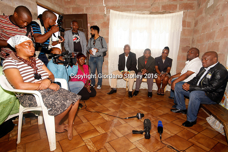 INCHANGA - 4 February 2016 - Barbara Dlamini (left) listens as Sihle Zikalala (right), chairman of the African National Congress (ANC) in KwaZulu-Natal expresses his condolences over the death of her husband Philip Dlamini, who was gunned down two weeks earlier at an SA Communist Party (SACP) meeting in Fredville, Inchanga. Looking on are other senior members of the ANC and SACP. Tensions between the ANC and its traditional partners, the SACP, have been high in the area, with SACP members accusing the ANC of preventing them from participating in nominations for the upcoming local government elections. Picture African News Agency. Picture: Allied Picture Press/APP