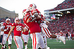 Wisconsin Badgers running back James White (20) celebrates a touchdown with teammates during an NCAA football game against the Brigham Young Cougars Saturday, November 9, 2013, in Madison, Wisc. The Badgers won 27-17. (Photo by David Stluka)