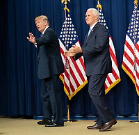 United States President Donald J. Trump and Vice President Mike Pence depart after signing S. 204, the &ldquo;Right to Try Act&rdquo; at the White House in Washington, DC, May 30, 2018.<br /> CAP/MPI/RS<br /> &copy;RS/MPI/Capital Pictures