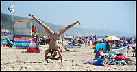 BNPS.co.uk (01202 558833)<br /> Pic: PhilYeomans/BNPS<br /> <br /> Freya Wardle-Tubbs(10) does cartwheels.<br /> <br /> Sizzling Sunday - Holidaymakers make the most of the first hot weekend of the year on Bmth beach today.