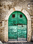Weathered green doors, arch, stone wall, hilltop cities of Guidonia-Montecelio, Italy