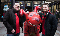 Wales fans posing on the high street with a Snow Dog statue<br /> <br /> Photographer Simon King/CameraSport<br /> <br /> International Rugby Union - 2017 Under Armour Series Autumn Internationals - Wales v Australia - Saturday 11th November 2017 - Principality Stadium - Cardiff<br /> <br /> World Copyright &copy; 2017 CameraSport. All rights reserved. 43 Linden Ave. Countesthorpe. Leicester. England. LE8 5PG - Tel: +44 (0) 116 277 4147 - admin@camerasport.com - www.camerasport.com