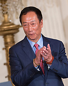 Foxconn CEO Terry Gou applauds during the announcement of the creation of a Foxconn Factory to be built in Wisconsin to build LCD flat screen monitors at The White House in Washington, DC, July 26, 2017.  <br /> Credit: Chris Kleponis / CNP