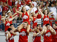 Ohio State cheerleaders run onto the field following a touchdown by wide receiver Devin Smith (9) during the fourth quarter of the NCAA football game at Ohio Stadium in Columbus on Sept. 27, 2014. (Adam Cairns / The Columbus Dispatch)