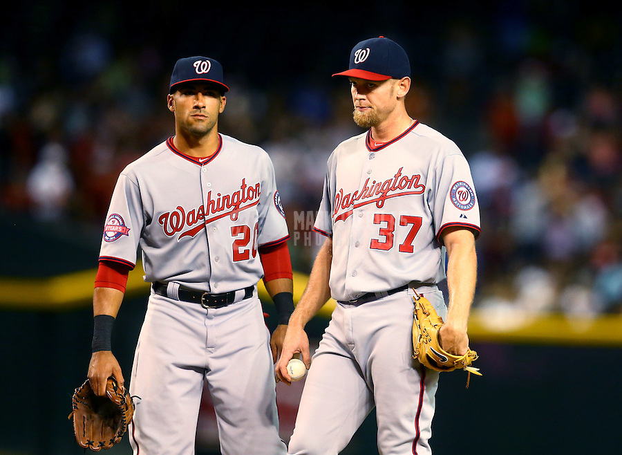 May 12, 2015; Phoenix, AZ, USA; Washington Nationals pitcher Stephen Strasburg (right) and shortstop Ian Desmond against the Arizona Diamondbacks at Chase Field. Mandatory Credit: Mark J. Rebilas-USA TODAY Sports