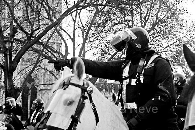 London, 09/12/2010. Student demonstration in London (and in several other locations across UK) organised by NCAFC (National Campaign Against Fees and Cuts), the Coalition of Resistance, NUS (National Union of Students),  Right to Work, UCU, Higher Education conference, Education Activist Network, London student assembly. Around 40,000 people protested on the day of the House of Commons vote to rise tuition fees up to £9,000 a year. After a march started from Malet Street the protesters were kettled in Parliament Square by police forces using riot gear, horses and vans. The protest ended on Westminster Bridge where the police herded the people and kettled them for approximately two hours.