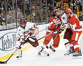 Steven Whitney (BC - 21), Max Nicastro (BU - 7), Paul Carey (BC - 22), Corey Trivino (BU - 10) - The Boston College Eagles defeated the Boston University Terriers 3-2 (OT) in their Beanpot opener on Monday, February 7, 2011, at TD Garden in Boston, Massachusetts.