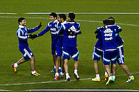 Sergio Aguero (L ) jokes as he reach Argentina players during a practice at Red Bull stadium ahead of his friendly match against Ecuador in New Jersey, Nov 13, 2013. VIEWpress/Eduardo Munoz Alvarez