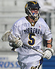 Jason Curran #5 of Shoreham-Wading River surveys the Yorktown defense during the NYSPHSAA varsity boys lacrosse Class B state semifinals at Hofstra University on Wednesday, June 8, 2016. He tallied two goals and two assists in defeat as Yorktown won by a score of 7-6.