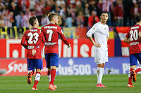 Players Atletico Madrid celebrating goal of Vietto and Real Madrid´s Cristiano Ronaldo