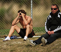 Canterbury's David Ambler and his coach Andrew MacLennan wait for the result of his protest against being disqualified in the men's 100m final during the National athletics championships at Newtown Park, Wellington, New Zealand on Friday, 27 March 2009. Photo: Dave Lintott / lintottphoto.co.nz