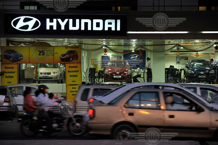 A traffic jam outside a Hyundai car showroom.