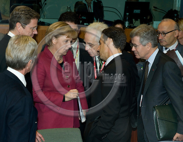 Brussels-Belgium - October 30, 2009 -- European Council, EU-summit under Swedish Presidency; here, Angela MERKEL (3.le), Federal Chancellor of Germany, surrounded by Guido WESTERWELLE (le), Minister for Foreign Affairs of Germany, Nicolas SARKOZY (3.ri), President of France, and Bernard KOUCHNER (le, from back), Minister for Foreign and European Affairs of France, interpreters and assistants -- Photo: Horst Wagner / eup-images