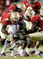 TALLAHASSEE, FL 11/19/11-FSU-UVA111911 CH-Virginia's Clifton Richardson is mobbed by the FSU defense during second half action Saturday at Doak Campbell Stadium in Tallahassee. The Seminoles lost to the Cavaliers 14-13..COLIN HACKLEY PHOTO