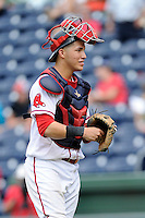 Catcher Carlos Coste (7) of the Greenville Drive in a game against the Asheville Tourists on Sunday, July 20, 2014, at Fluor Field at the West End in Greenville, South Carolina. Asheville won game two of a doubleheader, 3-2. (Tom Priddy/Four Seam Images)