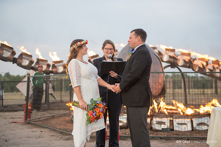 Photos of Elyse and Chris during their wedding ceremony under the Serpent Mother during Beakerhead 2017