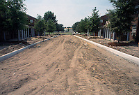 1993 June 21..Assisted Housing..Diggs Town (6-6)..Interim.Exterior.Road cut looking Northwest toward 1440 Melon Street...NEG#.NRHA#..HOUSING: DiggsTn1 20:2