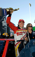 Sept. 19, 2010; Concord, NC, USA; NHRA pro mod driver Melanie Troxel celebrates after winning the O'Reilly Auto Parts NHRA Nationals at zMax Dragway. Mandatory Credit: Mark J. Rebilas-