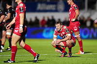 Scarlets players look dejected after the match. European Rugby Champions Cup match, between Saracens and the Scarlets on October 22, 2016 at Allianz Park in London, England. Photo by: Patrick Khachfe / JMP