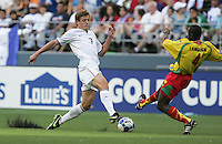 Robbie Rogers (7) brings up pieces of rubber from the turf against Cassim Langainge (4). USA defeated Grenada 4-0 during the First Round of the 2009 CONCACAF Gold Cup at Qwest Field in Seattle, Washington on July 4, 2009.