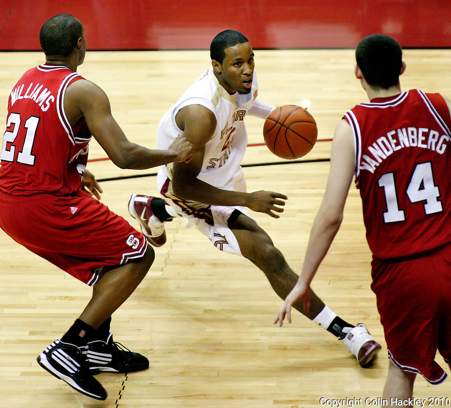 TALLAHASSEE, FL 10-FSU-NCSTBB10 CH03-Florida State's Michael Snaer threads between N.C. State's C.J. Williams, left, and Jordan Vandenberg during firs thalf action Tuesday at the Donald L. Tucker Center in Tallahassee...COLIN HACKLEY PHOTO