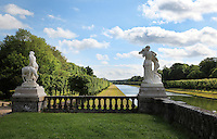 Grand Canal, created 1606-09 under Henri IV, with statues of water nymphs 1865 by Antoine Desboeufs, 1793-1862, in the gardens of the Chateau de Fontainebleau, France. The Palace of Fontainebleau is one of the largest French royal palaces and was begun in the early 16th century for Francois I. It was listed as a UNESCO World Heritage Site in 1981. Picture by Manuel Cohen