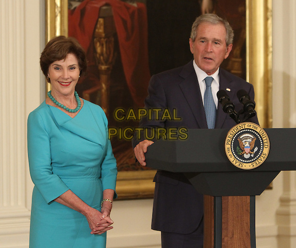 Former United States President George W. Bush speaks at the unveiling ceremony of his and former first lady Laura Bush's official White House portraits during a ceremony Thursday, May 31, 2012 at the White House in Washington, DC.  .half length blue dress tie black suit jacket podium speech married husband wife .CAP/ADM/CK.©Chris Kleponis/CNP/AdMedia/Capital Pictures.
