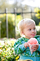 Finley Roessler enjoys her first snow cone at Pullen Park.