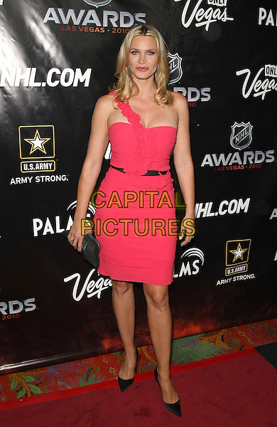 NATASHA HENSTRIDGE .The Stars of Hockey and Hollywood Walk the Red Carpet at The 2010 NHL Awards at the Palms Resort Casino, Las Vegas, Nevada, USA, 23rd June 2010..full length pink dress one shoulder strap black shoes waist belt ruffle .CAP/ADM/MJT.© MJT/AdMedia/Capital Pictures.
