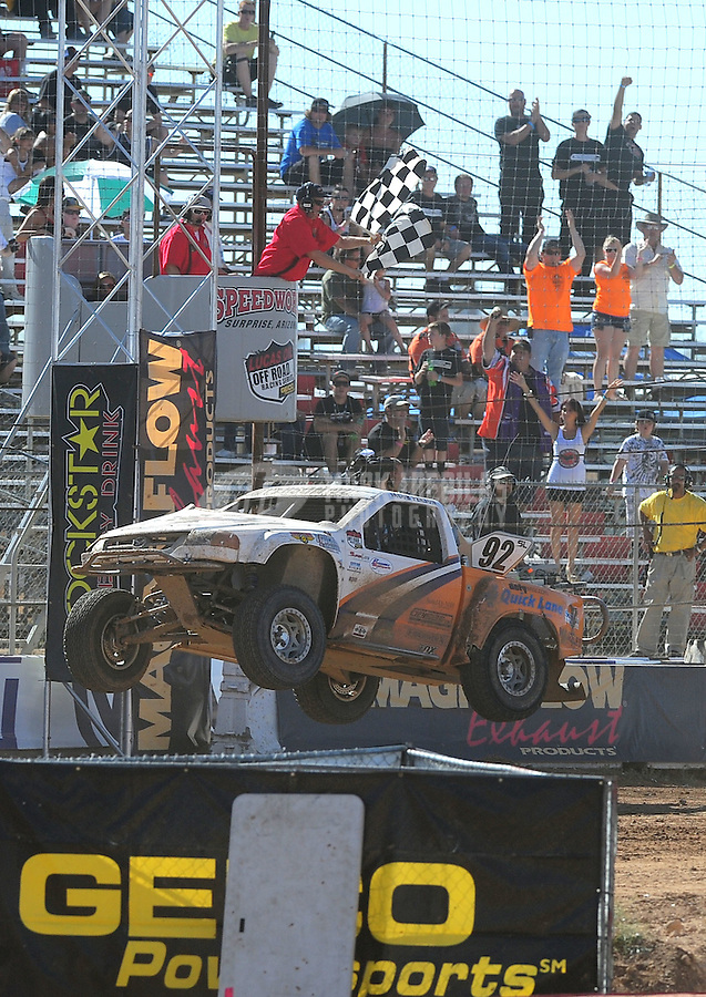 Apr 16, 2011; Surprise, AZ USA; LOORRS driver Jacob Person (92) takes the checkered flag to win round 3 at Speedworld Off Road Park. Mandatory Credit: Mark J. Rebilas-.