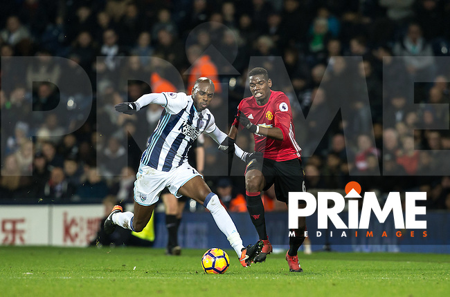 Paul Pogba of Manchester United & Allan-Romeo Nyom of West Bromwich Albion during the EPL - Premier League match between West Bromwich Albion and Manchester United at The Hawthorns, West Bromwich, England on 17 December 2016. Photo by Andy Rowland / PRiME Media Images.