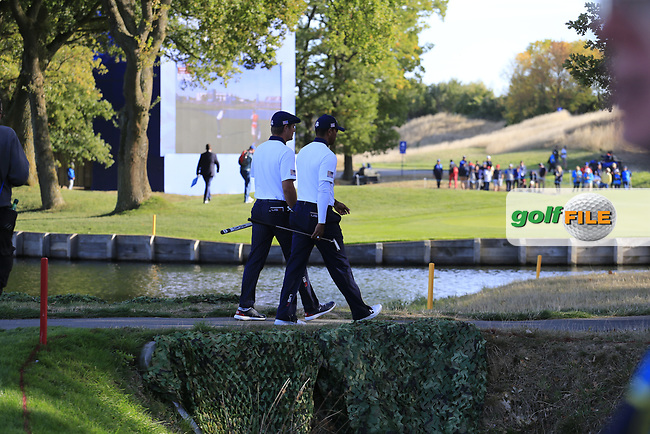 Tiger Woods and Bryson Dechambeau (Team USA) walk to the 13th green during Saturday's Foursomes Matches at the 2018 Ryder Cup 2018, Le Golf National, Ile-de-France, France. 29/09/2018.<br /> Picture Eoin Clarke / Golffile.ie<br /> <br /> All photo usage must carry mandatory copyright credit (© Golffile | Eoin Clarke)