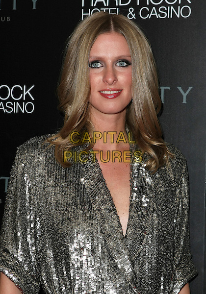NICKY HILTON.hosts Birthday for David Katzenberg at Vanity Nightclub inside the Hard Rock Hotel and Casino, 20th March 2010..half length  make-up eyeliner black lipstick  gold silver sequined sequin .CAP/ADM/MJT.©MJT/Admedia/Capital Pictures