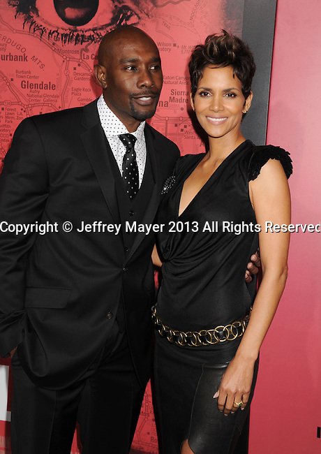 HOLLYWOOD, CA - MARCH 05: Morris Chestnut and Halle Berry arrive at the 'The Call' - Los Angeles Premiere at ArcLight Hollywood on March 5, 2013 in Hollywood, California.