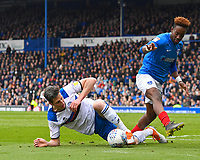 Jim McNulty of Rochdale wins the ball from Jamal Lowe of Portsmouth during Portsmouth vs Rochdale, Sky Bet EFL League 1 Football at Fratton Park on 13th April 2019