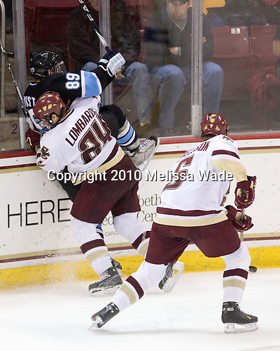 "Matt Lombardi (BC - 24) was given a minor penalty for ""holding"" Gustav Nyquist (Maine - 89) on this play. - The Boston College Eagles defeated the University of Maine Black Bears 6-1 on Friday, January 15, 2010, at Conte Forum in Chestnut Hill, Massachusetts."