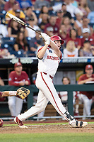 Arkansas Razorbacks outfielder Heston Kjerstad (18) follows through on his swing during Game 2 of the NCAA College World Series against the Florida State Seminoles on June 15, 2019 at TD Ameritrade Park in Omaha, Nebraska. Florida State defeated Arkansas 1-0. (Andrew Woolley/Four Seam Images)