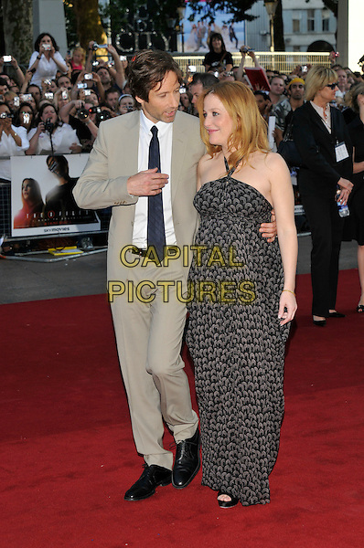 """DAVID DUCHOVNY & GILLIAN ANDERSON.Arrivals - """"The X-Files: I Want to Believe"""".UK  film premiere held at Empire Cinema, Leicester Square, London, England, 30th July 2008..X files arrivals full length grey beige suit white shirt black tie print halterneck maxi dress pregnant peep toe heels shoes.CAP/PL.©Phil Loftus/Capital Pictures"""