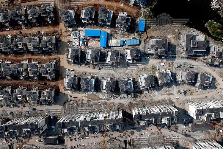 High rise residential blocks and a low rise housing estate under construction. /Felix Features