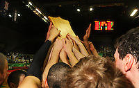 The tall Blacks hold the Al Ramsay Shield aloft after victory during the International basketball match between the NZ Tall Blacks and Australian Boomers at TSB Bank Arena, Wellington, New Zealand on 25 August 2009. Photo: Dave Lintott / lintottphoto.co.nz
